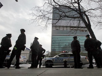 New York Police Department officers stand outside United Nations headquarters during a dirty bomb exercise on April 5, 2011 in New York City. Officers from 150 law enforcement and first responder agencies are conducting the five-day, three-state exercise to evaluate responses to a hypothetical radiological bomb. (Mario Tama/Getty Images)