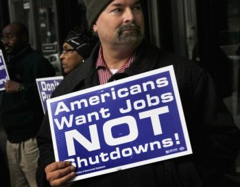 SHUTDOWN WORRIES: Federal Employees demonstrate on April 7 outside the Ralph H. Metcalfe Federal Building in Chicago, Ill. If a deal is not reached on the federal budget before midnight on Friday non-essential government services are expected to be shutdown. (Scott Olson/Getty Images )