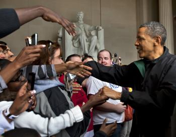 President Obama shakes the hands of tourists visiting the Lincoln Memorial during a surprise visit a day after budget negotiations with Congress prevented a government shutdown April 9,  in Washington, DC.  (Jim Lo Scalzo-Pool/Getty Images)