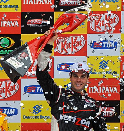 Will Power celebrates at the podium with the Sao Paulo Indy 300 trophy. (Nelson Almeida/AFP/Getty Images)
