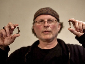 Simcha Jacobovici, the producer of Secrets Of Christianity series, shows the Roman nails which he believes may have been used in the crucifixion of Jesus, during a press conference in Jerusalem, on April 12,2011.  (Menahem Kahana/AFP/Getty Images)