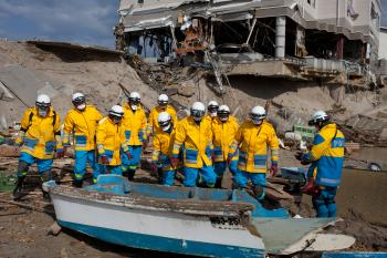 Japanese police officers check a wrecked boat as they search for tsunami victims in Minamisanriku, Miyagi prefecture on April 12.  (Yasuyoshi Chiba/Getty Images )