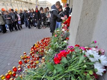 People lay flowers and place candles outside a metro station hit by a blast in downtown Minsk, on April 12, 2011. (Viktor Drachev/AFP/Getty Images)