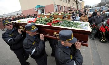 Belarussian policemen carry the coffins of Galina Pikulik (background) and Anatoliy Narkevich, victims of the Minsk metro bombing that killed 12 and wounded 200 on April 11, during a funeral ceremony on April 13, 2011.  (Viktor Drachev/AFP/Getty Images)
