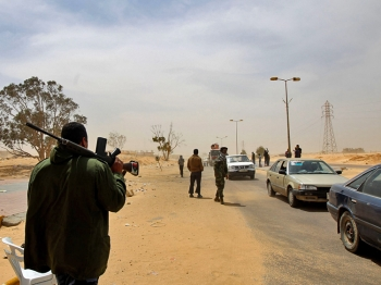 Libyan rebels man a checkpoint as civilians flee the town of Ajdabiya on April 17, 2011.  (Marwan Naamani/AFP/Getty Images)