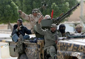 Libyan rebels flash the V-sign as they drive to the eastern town of Ajdabiya on April 17, 2011. (Marwan Naamani/AFP/Getty Images)