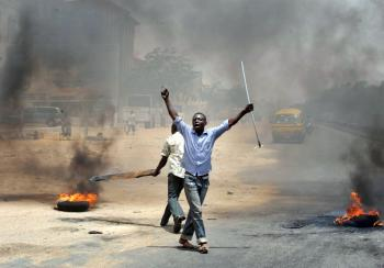 People holding wooden and metal sticks demonstrate in Nigeria's northern city of Kano where running battles broke out between protesters and soldiers on April 18, 2011 as President Goodluck Jonathan headed for an election win.  (Seyllou Diallo/AFP/Getty Image)