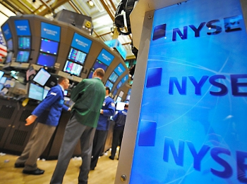 STOCKS JUMP: Workers are seen on the floor of the New York Stock Exchange Wednesday April 20. U.S. markets gained across the board as corporate earnings propelled stocks higher. (Stan Honda/AFP/Getty Images)