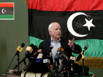 U.S. Republican Sen. John McCain speaks during a press conference in the Libyan rebel stronghold of Benghazi on April 22. (Marwan Naamani/AFP/Getty Images)