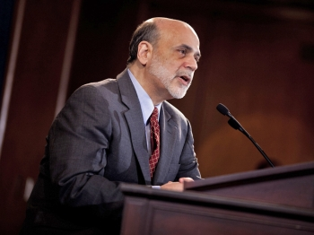 Federal Reserve Chairman Ben Bernanke speaks during his first news briefing at the Federal Reserve's Board of Governors building April 27, 2011 in Washington, DC. (Brendan Smialowski/Getty Images)