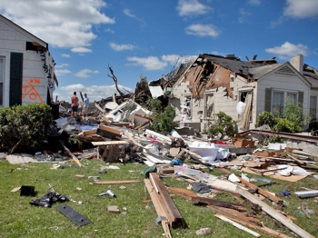 In the aftermath of a severe tornado, debris from homes in the Cedar Crest neighborhood that were destroyed lies on the lawns on April 28, 2011 in Tuscaloosa, Alabama. As of 8 a.m., at least 131 deaths were accounted for in Alabama. (Jessica McGowan/Getty Images)