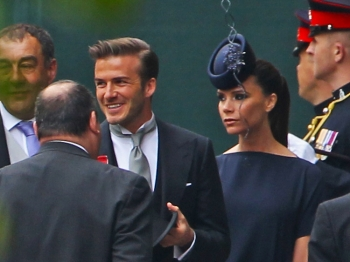 David Beckham and Victoria Beckham arrive to attend the royal wedding of Prince William and Catherine Middleton at Westminster Abbey on Friday. (Dan Kitwood/Getty Images)
