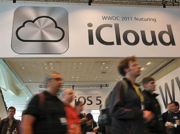 Attendees walk by a sign for the new iCloud during the 2011 Apple World Wide Developers Conference at the Moscone Center on June 6, in San Francisco, California. (Justin Sullivan/Getty Images)