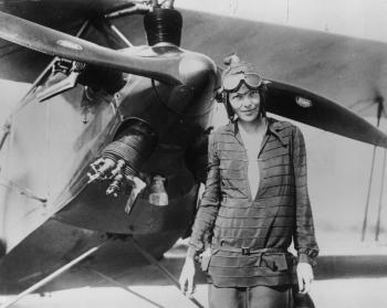 Amelia Earhart stands June 14, 1928 in front of her bi-plane called 'Friendship' in Newfoundland. Earhart (1898 - 1937) disappeared without trace over the Pacific Ocean in her attempt to fly around the world in 1937.  (Photo by Getty Images)
