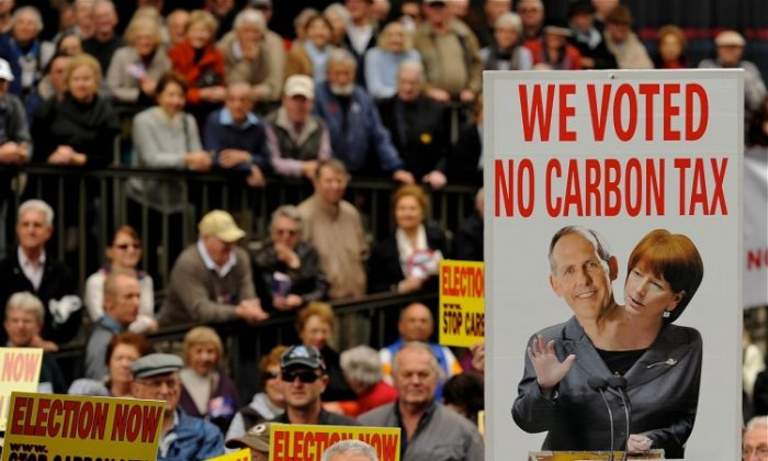 Protesters hold placards during a rally in Sydney on July 1, 2011 against Australian Prime Minister Julia Gillard's plans to introduce a carbon tax. (Greg Wood/AFP/Getty Images)