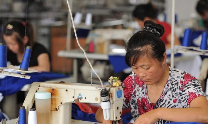 Photo, taken in 2011, shows laborers working at a clothes factory in Hefei, in east China's Anhui Province. China's garment manufacturing industry is experiencing a downturn. (STR/AFP/Getty Images)