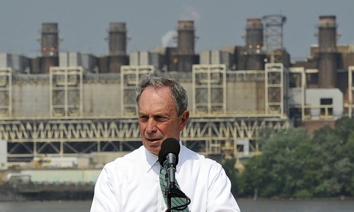 New York Mayor Michael Bloomberg speaks during a press conference on the deck of a boat idling in front of a coal-fired power plant in Alexandria, Virginia, on July 21, 2011. Bloomberg announced to donate 50 million US dollars to Sierra Club for their 'Beyond Coal Campaign' aimed to move America toward cleaner energy. (Jewel Samad/AFP/Getty Images)