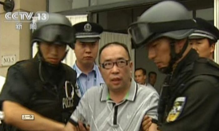 A TV grab from July 23, 2011. Lai Changxing, the most-wanted man in China and a highly successful smuggler, was sentenced to life in prison. (STR/AFP/Getty Images)