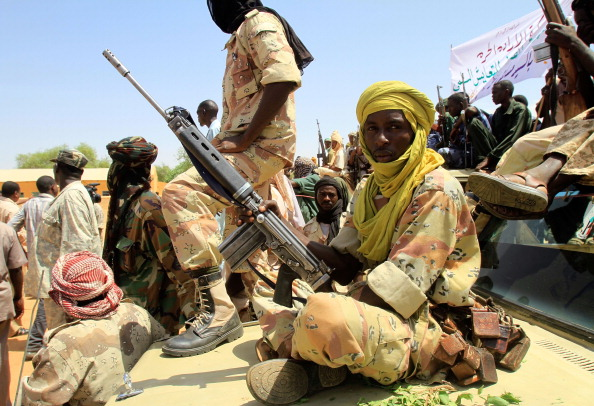 One of some 300 fighters of the Justice and Equality (JEM) Movement holds his rifles as they wait to greet Sudanese presidential adviser Nafie Ali Nafie during his visit to al-Fasher, Northern Darfur, on July 25, 2011. (Ashraf Shazly/AFP/Getty Images)