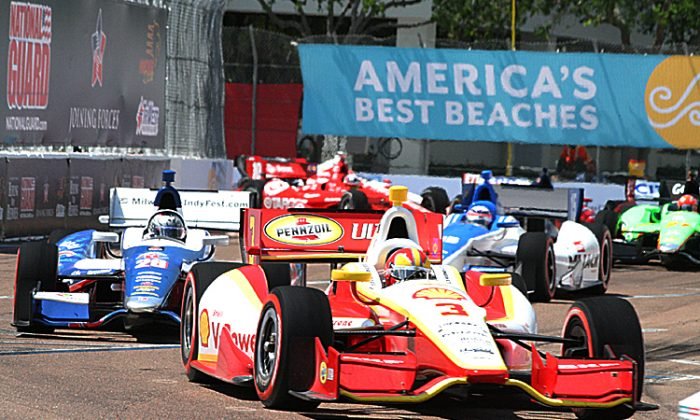 Helio Castroneves speeds through the streets of St. Petersburg. IndyCar will be bringing its intense street-racing action to Houston starting in 2013. (James Fish/The Epoch Times)