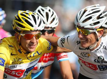 Overall race winner Carlos Sastre of Team CSC Saxobank (L) is congratulated by teammate Andy Schleck as he crosses the finish line on the Champs Elysees during Stage Twenty One of the 2008 Tour de France  (Bryn Lennon/Getty Images)