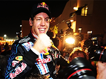 Sebastian Vettel of Red Bull Racing celebrates in the paddock with team mates after winning the Abu Dhabi Formula One Grand Prix at the Yas Marina Circuit on November 1, 2009 in Abu Dhabi, United Arab Emirates. (Clive Mason/Getty Images)