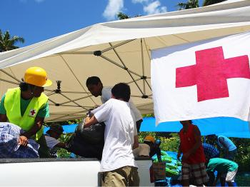 Red Cross volunteers stack aid supplies of clothing following the 8.3 magnitude earthquake which struck 200km from Samoa's capital Apia on October 1, 2009. (Phil Walter/Getty Images)