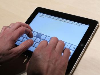 A guest plays with the new keyboard on a Apple iPad during an Apple Special Event at Yerba Buena Center for the Arts. (Justin Sullivan/Getty Images)