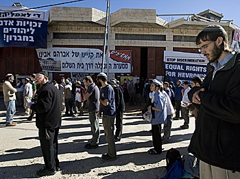 Israeli settlers pray outside a disputed house in the flashpoint West Bank city of Hebron on December 3, 2008.    (Menahem Kahana/AFP/Getty Images)