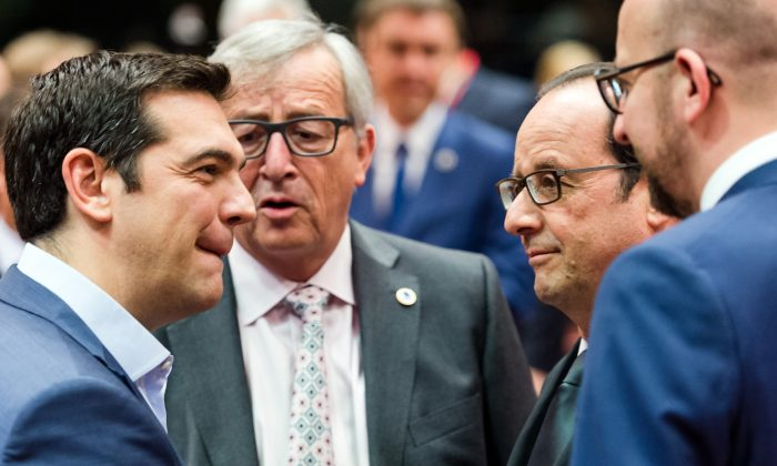(L-R) Greek Prime Minister Alexis Tsipras, European Commission President Jean-Claude Juncker, French President Francois Hollande, and Belgian Prime Minister Charles Michel at a meeting of eurozone heads of state at the EU Council building in Brussels on July 12, 2015. (AP Photo/Geert Vanden Wijngaert)