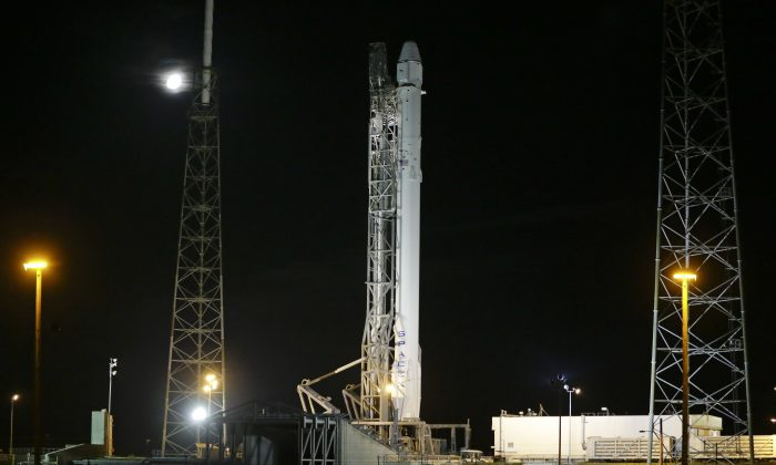 The SpaceX Falcon 9 rocket and Dragon spacecraft stands ready for launch on Space Launch Complex 40 at the Cape Canaveral Air Force Station in Cape Canaveral, Fla., early Sunday, June 28, 2015.  (AP Photo/John Raoux)