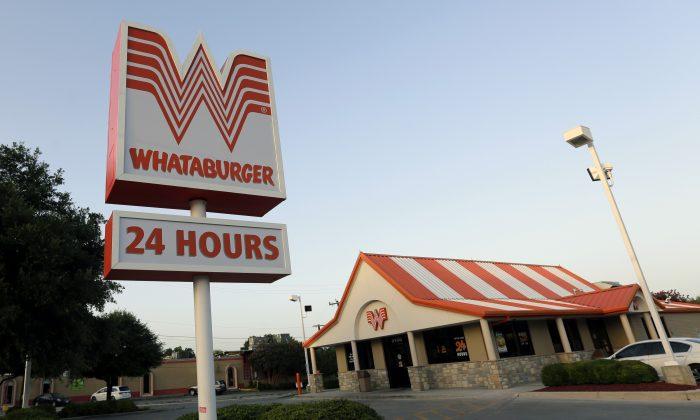 This Thursday, July 9, 2015 photo shows a Whataburger restaurant in San Antonio, Texas.  (AP Photo/Eric Gay)