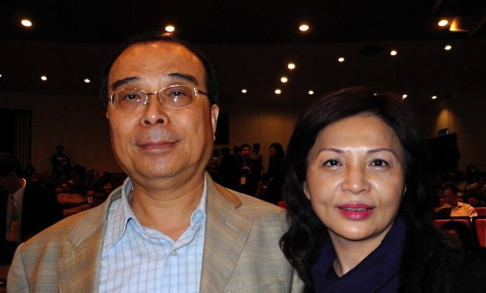 General manager Xiuping Lin and his wife attend Shen Yun Performing Arts on Mar. 7. (Deman Dai/The Epoch Times)