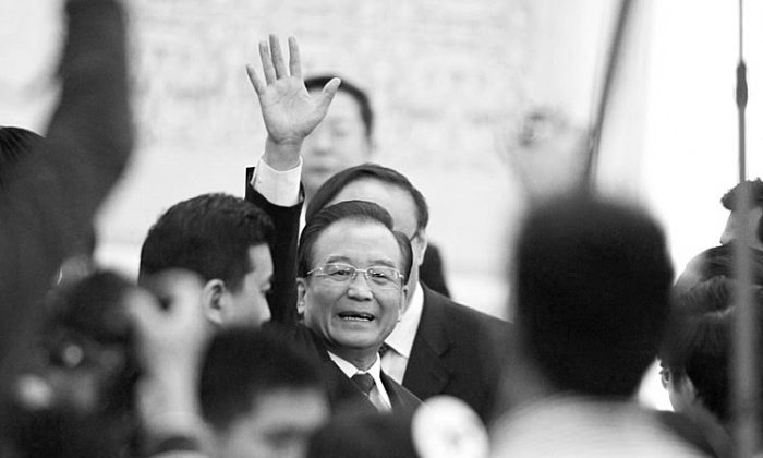 Chinese Premier Wen Jiabao waves to media as leaves after a press conference of the National People's Congress's (NPC) annual session at the Great Hall of the People in Beijing on March 14, 2012. (Liu Jin/AFP/Getty Images)