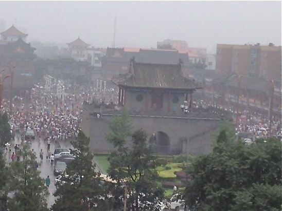 Thousands of people turn out in a local square to mourn victims of the June 30 Tianjin shopping mall fire. (Posted to Internet by a Chinese blogger on July 6)