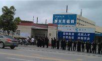 Strikers in Shanghai Struck by Riot Police