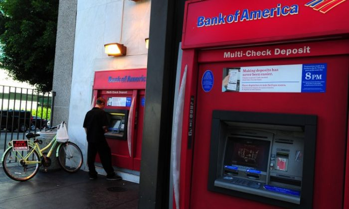 A man uses an automated teller machine (ATM) in front of a branch of Bank of America in Hollywood, California in August 2011. (Frederic J. Brown/AFP/Getty Images)