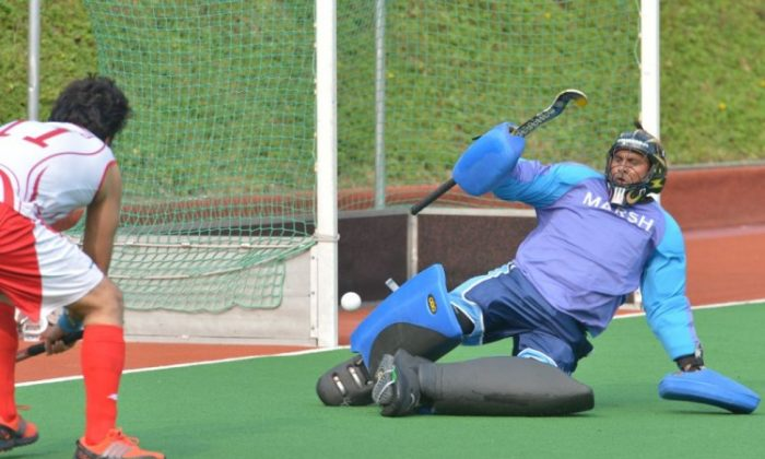 Players from SSSC-A and Punjab-A vie for the ball in their Hong Kong Hockey Association Premier League match at Kings Park on Sunday Oct 7. (Bill Cox/Epoch Times Staff)