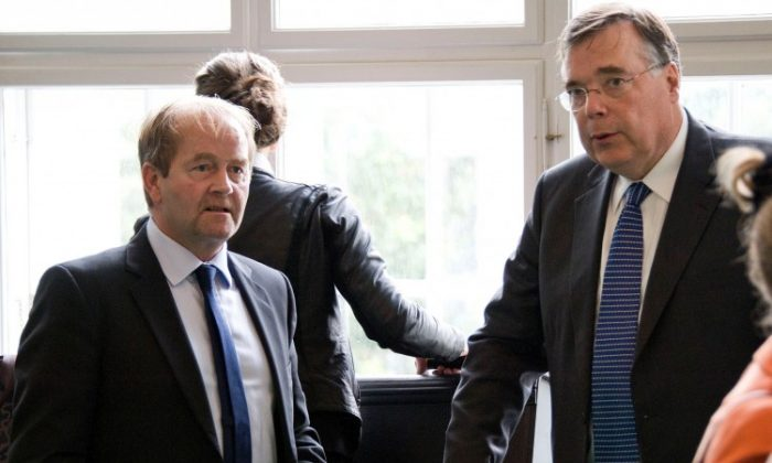 Iceland's former Prime Minister Geir Haarde (R) and his lawyer Andri Arnason (L), are seen on Sept. 5, 2011, at the Icelandic Culture House in Reykjavik during Haarde's trial for allegedly contributing to the country's economic collapse. (Halldor Kolbeins/AFP/Getty Images)
