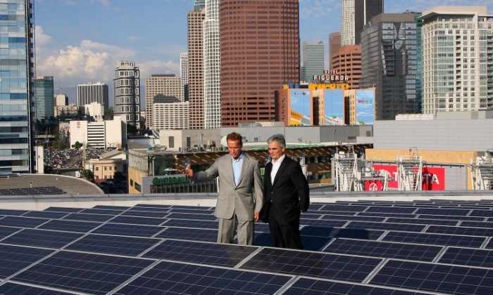 Former governor Arnold Schwarzenegger and Austrian Chancellor Werner Faymann tour Staples Center PV roof during the Solar Energy Research Labs Tour on September 23, 2011 in Los Angeles, California. (Maury Phillips/Getty Images For Mercury LLC)