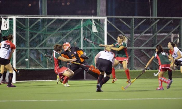 On the attack ... Valley-A forwards applied strong pressure to score early in the second half in their Hong Kong Hockey Association Women's Premier League match against KCC-A at the Valley ground on Saturday Nov 3. Valley-A won 3-0. (Bill Cox/The Epoch Times)