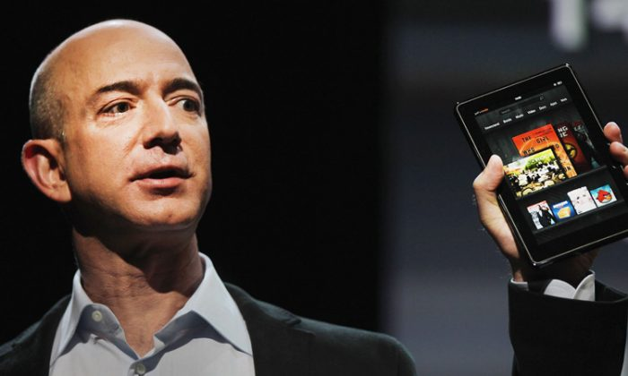 Amazon CEO Jeff Bezos is seen introducing the Kindle Fire tablet computer at a press event last year. (Spencer Platt/Getty Images)