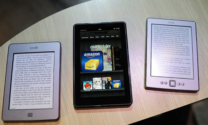 Amazon's Kindle products (L-R), Kindle Touch, Kindle Fire tablet, and new Kindle are displayed at a press conference in New York on Sept. 28, 2011. Amazon will reportedly test out a new retail store in Seattle to sell certain high-margin and Kindle products. (EMMANUEL DUNAND/AFP/Getty Images)