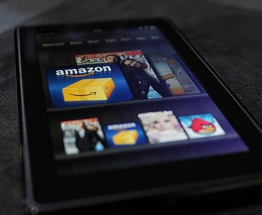 The Amazon Kindle Fire tablet is displayed at a press conference in New York on Sept. 28, 2011. Some publishing companies may have to rearrange their approach to selling books in today's market.(EMMANUEL DUNAND/AFP/Getty Images)
