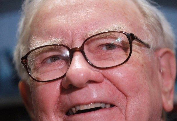 Billionaire investor Warren Buffett is seen on the floor of the New York Stock Exchang last September. Buffett briefed investors on Berkshire Hathaway's fourth-quarter earnings, and said that he has identified a successor as the company's future CEO. (Mario Tama/Getty Images)