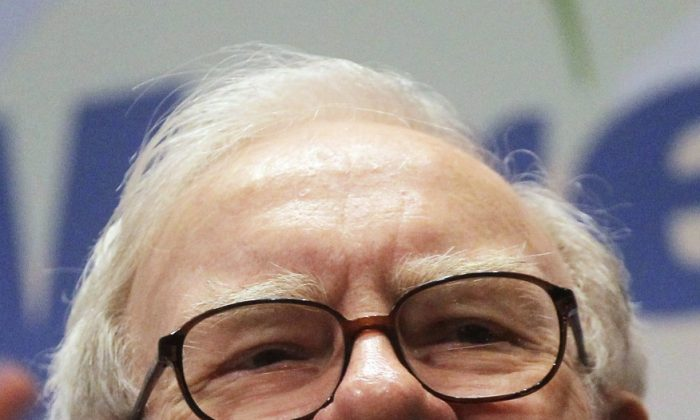 Berkshire Hathaway Inc. Chairman and CEO Warren Buffett smiles at the New York Stock Exchange before ringing the opening bell, Sept. 30. Buffett announced Monday that his company has made a $10.7 billion investment in IBM. (Mario Tama/Getty Images)