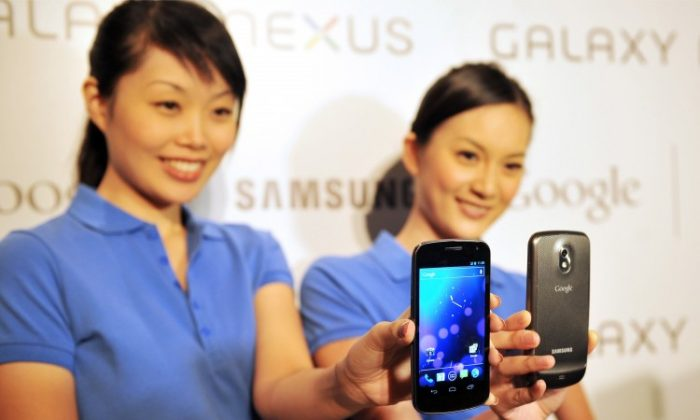 Models hold the new Samsung Galaxy Nexus Android phone during its official launch in Hong Kong on Oct. 19, 2011. Samsung has become the world's No. 1 smartphone maker. (LAURENT FIEVET/Getty Images)