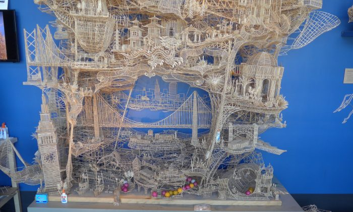 Scott Weaver's several-foot-tall toothpick sculpture, exhibited at the Exploratorium, shows San Francisco City and has pathways for ping pong balls to roll down. CORNELIA RITTER/EPOCH TIMES