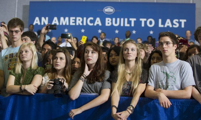 Junior and senior high school students listen as US President Barack Obama speaks on the interest rates of federal subsidized student loans at Washington-Lee High School in Arlington, Virginia, May 4, 2012. (Saul Loeb/AFP/GettyImages)