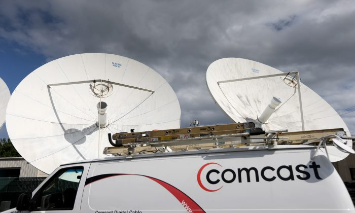 A Comcast truck is seen parked at one of their centers on February 13, 2014 in Pompano Beach, Florida. (Photo by Joe Raedle/Getty Images)
